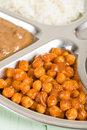 Chana masala spicy chickpea curry served with in a thali Stock Image