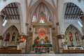 The chancel altar area of saint mary s cathedral in bangalore and with many statues and bas relief at catholic basilica bengaluru Royalty Free Stock Photography