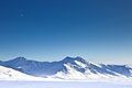 Chandalar shelf in winter alaska crescent moon clear blue sky over snow covered peaks the arctic circle of Stock Images
