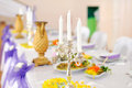 Chandelier on festive table silver with white candles Royalty Free Stock Photo