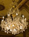 Chandelier hanging under a ceiling in a palace Royalty Free Stock Image