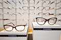 Chanel eyeglass frames on display in optician store in poland Royalty Free Stock Image