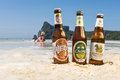 Chang,Singha and Leo beer on the beach Royalty Free Stock Photo