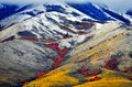 Change from autumn to winter fall colors in the mountains with first blanket of snow at the top Stock Photography