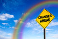 Changes ahead sign with rainbow background against a blue sky concept of situation change for the better Royalty Free Stock Photo