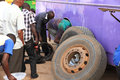 Changing a bus tire and brakes in africa mbarara uganda september maintenance worker changes the back tires of broken down horizon Royalty Free Stock Photo