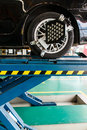 Changing car wheel with at maintenance repair service station Stock Image