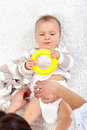 Changing diapers on a baby girl Royalty Free Stock Photo