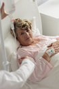 Changing the drip doctor to older sick patient Stock Photography