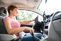 Changing gear woman driving car and hand and gearshift in focus Stock Images