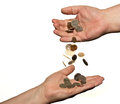 Changing hands coins dropping from on hand to another isolated on white background Royalty Free Stock Photo