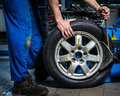 Changing tires replacement in the garage Stock Images