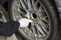 Changing a wheel mechanic tightening the screws of of car competition Royalty Free Stock Photos