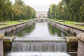 Channel of peterhof palace st petersburg and fountains in russia Stock Images