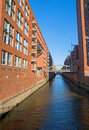 Channel in the speicherstadt one of many channels hamburg germany Royalty Free Stock Photo