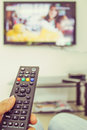 Channel surfing with remote control in hand Royalty Free Stock Photo