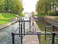 Channels of sluice in water barrier wooden lock gates and dam river rhine on october at werkhoven the netherlands Royalty Free Stock Photos