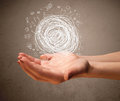 Chaos concept in the hand of a woman Royalty Free Stock Photo