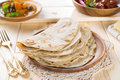 Chapatti roti or flat bread curry chicken and dhal indian food on dining table Stock Photos