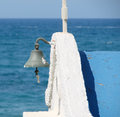 Chapel bell in crete by the sea Stock Photos