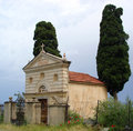 Chapel between cypress trees small chappel two in corsica france Royalty Free Stock Images