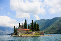 Chapel on the island an old historic a small islands with trees surrounding it in privacy canal going through mountains of big Royalty Free Stock Images