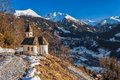 Chapel in the mountains overlooking the town of Bad Gastein. Austrian Alps. Royalty Free Stock Photo