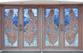 Chapel wooden door decorated decorate with stained glass Stock Image