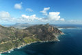 Chapmans peak drive aerial view of the bay of hout bay suburb of cape town south africa and view over and the cape peninsula Royalty Free Stock Photo