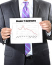 Chapter bankruptcy concept with business man in suit Stock Photos