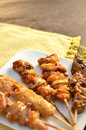 Char-broiled chicken called yakitori. Royalty Free Stock Image