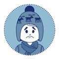 Character sad boy in winter hat and scarf knitted Royalty Free Stock Photo