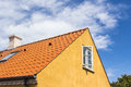 Characteristic skagen housing a house from with yellow walls red roofs and white joints in the end of the roofs Royalty Free Stock Photo