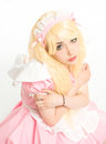 Characterized maid manga girl makeup gesticulating in the studio Royalty Free Stock Photo