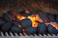 Charcoal briquettes with fire sparks ready for barbecue grill Stock Photography