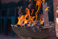 Charcoal flames in rusty old grill Royalty Free Stock Photos