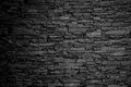 Charcoal stone wall background texture black and white Royalty Free Stock Photo