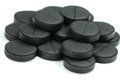 Charcoal tablets activated on a white background Royalty Free Stock Photos
