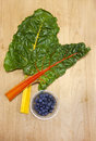 Chard and dish of blueberries. Royalty Free Stock Photo