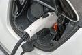 Charging an electric car closeup