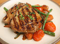 Chargrilled tuna fish steak with vegetables marinated stir fried Royalty Free Stock Photography