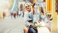 Charimgn lady riding a retro scooter with her boyfriend Royalty Free Stock Photo