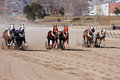 Chariot racing on a sandy track Stock Photos