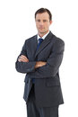 Charismatic businessman standing with arms crossed Royalty Free Stock Photo