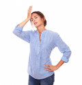 Charismatic hispanic lady with headache standing portrait of on blue shirt on isolated white background Royalty Free Stock Images