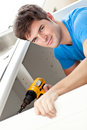 Charismatic man repairing his sink Royalty Free Stock Photo