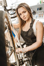 Charismatic young craftswoman standing in the repair shop Royalty Free Stock Photo