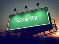 Charity billboard on the sunrise background green rising sun Royalty Free Stock Photo