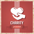 Charity on red striped background in flat design with heart hand and slogan ribbon vintage concept Royalty Free Stock Photography