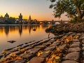 Charles Bridge with Old Town Bridge Tower reflected in Vltava River at morning sunrise time, Prague, Czech Republic